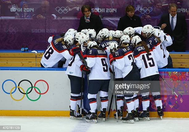 The United States huddle around the bench late in the game against Canada during the Ice Hockey Women's Gold Medal Game on day 13 of the Sochi 2014...