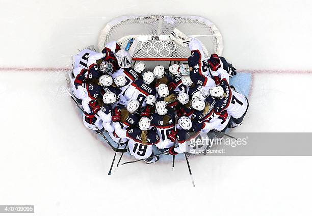 The United States huddles around the net before the game against Canada during the Ice Hockey Women's Gold Medal Game on day 13 of the Sochi 2014...