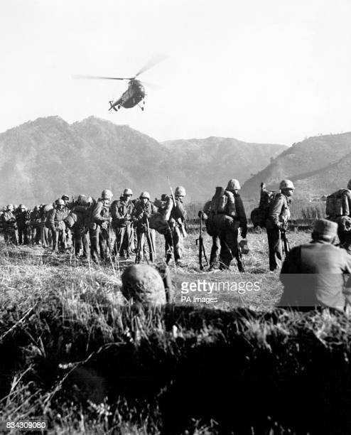The United States Marine transport helicopter is bringing a load of battleweary US Marines into a rear area in Korea while on the ground relief...