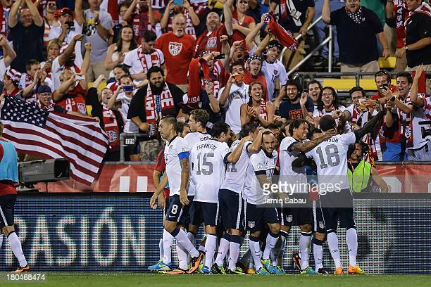 The United States Men's National Team celebrates a goal against Mexico at Columbus Crew Stadium on September 10 2013 in Columbus Ohio