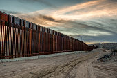 The iconic and controversial iron border wall between the USA and Mexico