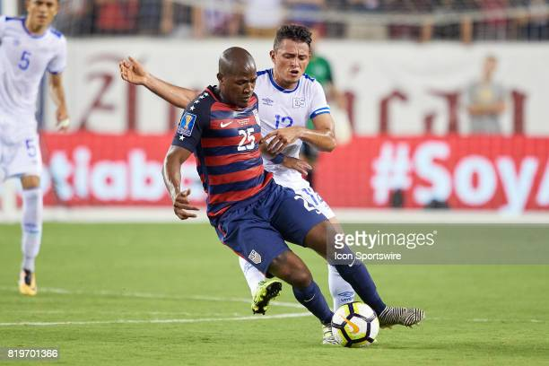 the United States midfielder Darlington Nagbe battles with El Salvador midfielder Narcisco Orellana for the ball during a CONCACAF Gold Cup...