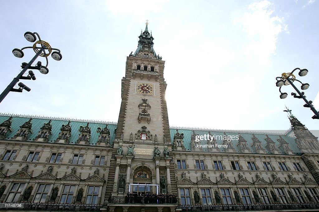 The United States National Team stands on the balcony of the Hamburg Rathaus as they are officially welcomed by Hamburg mayor Ole von Buest on June 7...