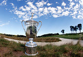 The United States Open Championship Trophy is seen at the Church Pew bunkers between the 3rd and 4th fairways during the 2016 US Open Media Day at...