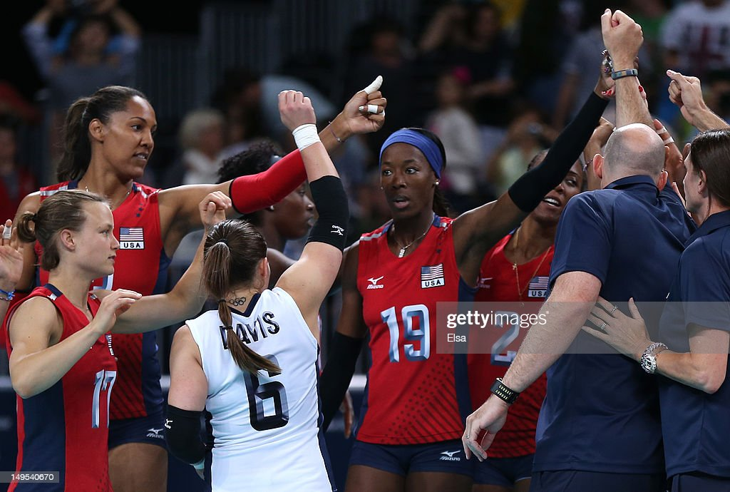 The United States player celebrate winning the Women's Volleyball Preliminary match between the United States and Brazil on Day 3 of the London 2012 Olympic Games at Earls Court on July 30, 2012 in London, England.