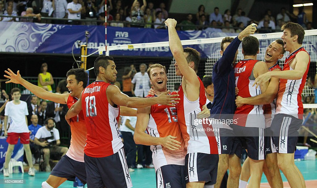 The United States players celebrate their victory of the FIVB World League Final Six at Mandela Forum on July 20, 2014 in Florence, Italy.