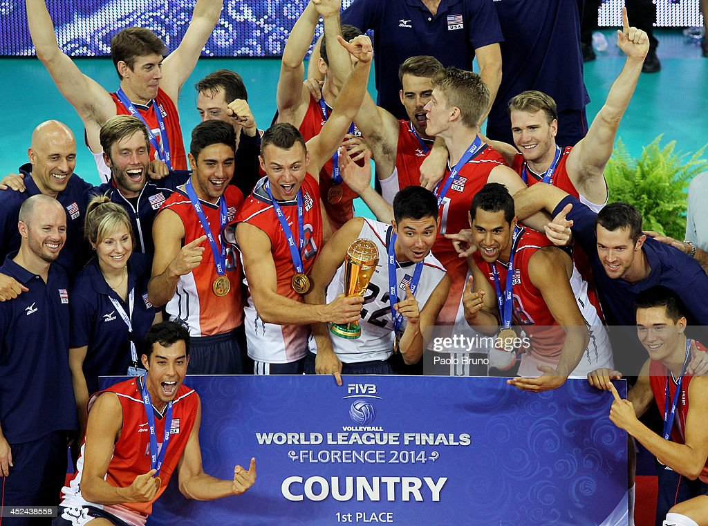 The United States players celebrate with the trophy the victory of the FIVB World League Final Six at Mandela Forum on July 20, 2014 in Florence, Italy.