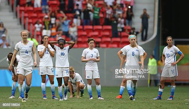 The United States players look dejected after losing in the penalty shoot out during the Women's Quarter Final match between United States and Sweden...