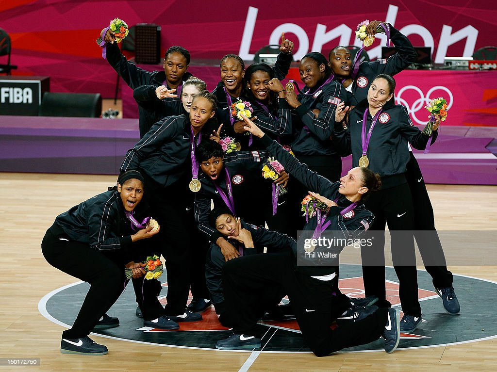 The United States players pose for a photo with their gold medals during the medal ceremony for the Women's Basketball on Day 15 of the London 2012 Olympic Games at North Greenwich Arena on August 11, 2012 in London, England.