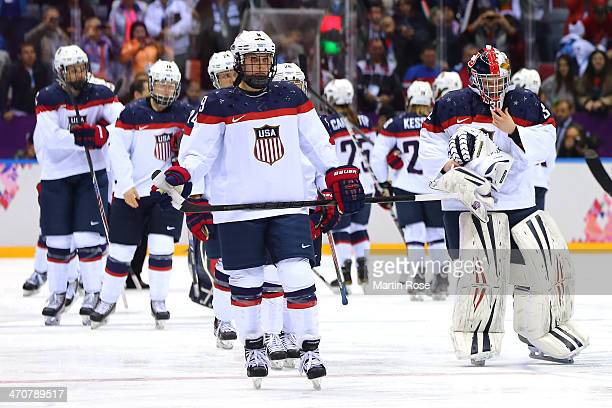 The United States react after losing to Canada 32 in overtime during the Ice Hockey Women's Gold Medal Game on day 13 of the Sochi 2014 Winter...
