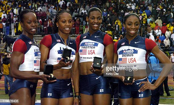 The United States Red women's 1600meter relay Monique Hennagan Sanya Richards DeeDee Trotter and Lashinda Demus pose after winning in 32293 in the...