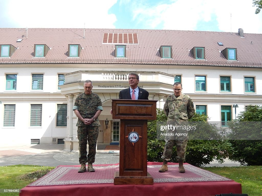 The United States Secretary of Defense Ash Carter (C) speaks to the press as US Marine Corps General Joseph Dunford (L) and US Army General Curtis Scaparrotti, the new commanding officer of US and NATO troops in Europe, stand on stage during the change in command at the United States European Command (EUCOM), in Stuttgart, Germany, 03 May 2016.