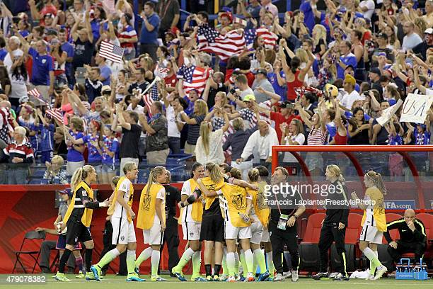 The United States sideline celebrates after Carli Lloyd scores on a penalty kick in the second half against Germany in the FIFA Women's World Cup...