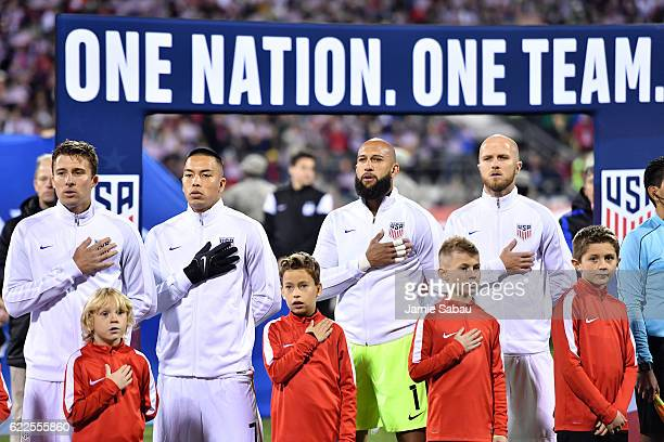 The United States stand for the playing of the National Anthem prior to the FIFA 2018 World Cup Qualifier against Mexico at MAPFRE Stadium on...