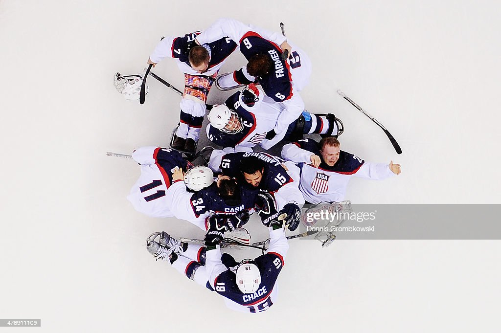 The United States team celebrate winning the gold medal after the Ice Sledge Hockey Gold Medal game between the United States and Russia on day eight of the Sochi 2014 Paralympic Winter Games at Shayba Arena on March 15, 2014 in Sochi, Russia.