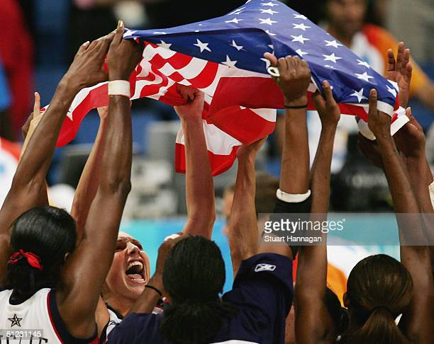 The United States team celebrate winning the gold medal in the women's basketball gold medal match between United States of America and Australia on...