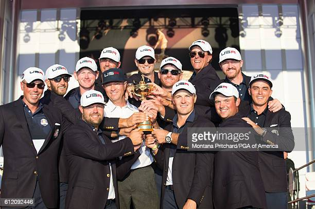 The United States Team gather for a photo with the Ryder Cup trophy during the Trophy Presentation for the 41st Ryder Cup at Hazeltine National Golf...