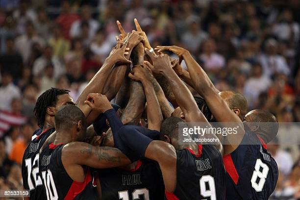 The United States team huddles at center court after defeating Spain 118107 in the gold medal game during Day 16 of the Beijing 2008 Olympic Games at...
