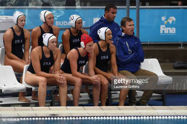 The United States team look on from the bench during the Women's Water Polo Quarterfinal against Australia on day eleven of the Budapest 2017 FINA...