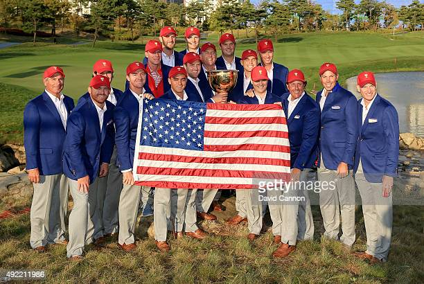 The United States team pose with the Presidents Cup after their 155 to 145 win during the Sunday singles matches in the 2015 Presidents Cup at the...