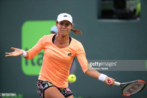 The United States' Varvara Lepchenko returns a shot to Denmark's Caroline Wozniacki in the second round of the Miami Open at Crandon Park in Key...