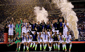 The United States Womens National team celebrates winning the 2016 SheBelieves Cup at FAU Stadium on March 9 2016 in Boca Raton Florida