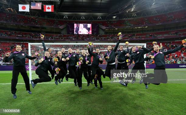 The United States women's soccer team celebrates with the the gold medal after defeating Japan by a score of 21 to win the Women's Football gold...