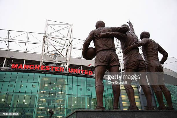 The United Trinity statue is seen outside the stadium prior to the Barclays Premier League match between Manchester United and West Ham United at Old...