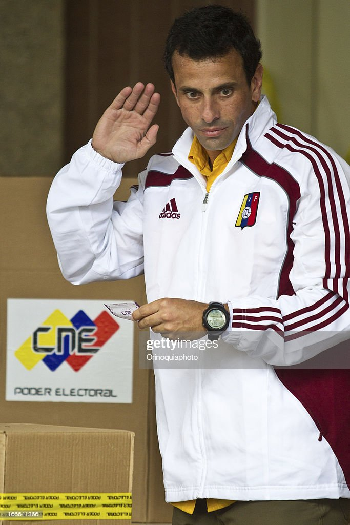 The Unity candidate, Henrique Capriles, votes in Santo Tomas de Villanueva school on April 14, 2013 in Caracas, Venezuela.