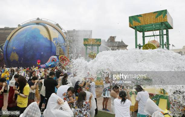 The Universal Summer Festival which involves people getting soaked with water from being splashed at Universal Studios Japan in Osaka is shown to the...