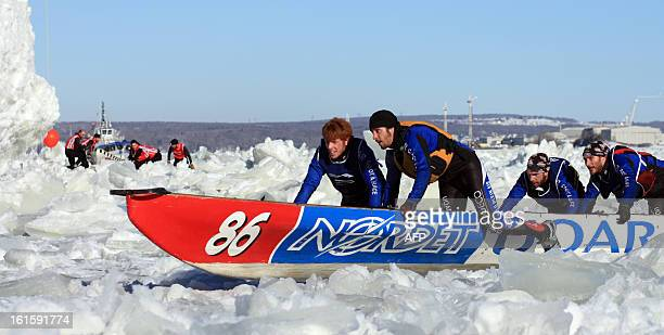 The Université du Québec à Rimouski team engage in the canoe race on the St Lawrence River in Quebec City on February 10 Canoe Races snow baths...