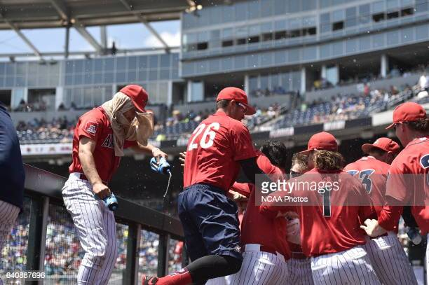 The University of Arizona Wildcats cheer after a great play against Coastal Carolina University during Game 3 of the Division I Men's Baseball...