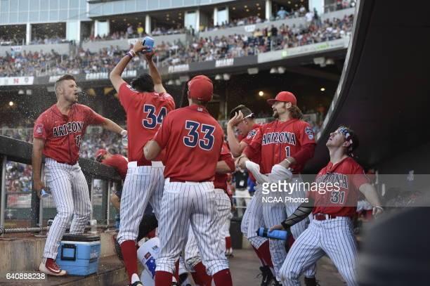 The University of Arizona Wildcats dugout explodes with celebration against Coastal Carolina University during the Division I Men's Baseball...