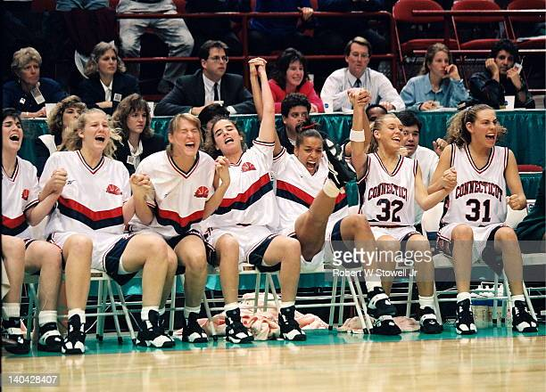 The University of Connecticut bench celebrates during the last seconds of the championship game victory against the University of Tennessee...