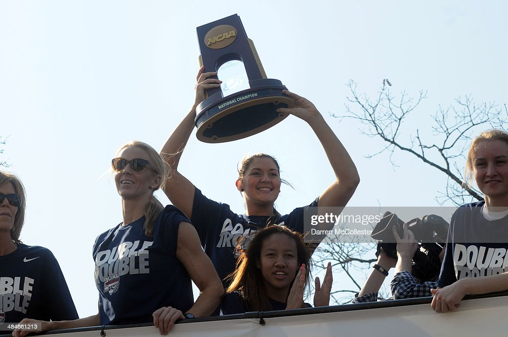 The University of Connecticut Stefanie Dolson holds the NCAA champsionship trophy during a victory parade April 13, 2014 in Hartford, Connecticut. This year was the second time both the men's and women's Uconn basketball teams have won national championships in the same year.