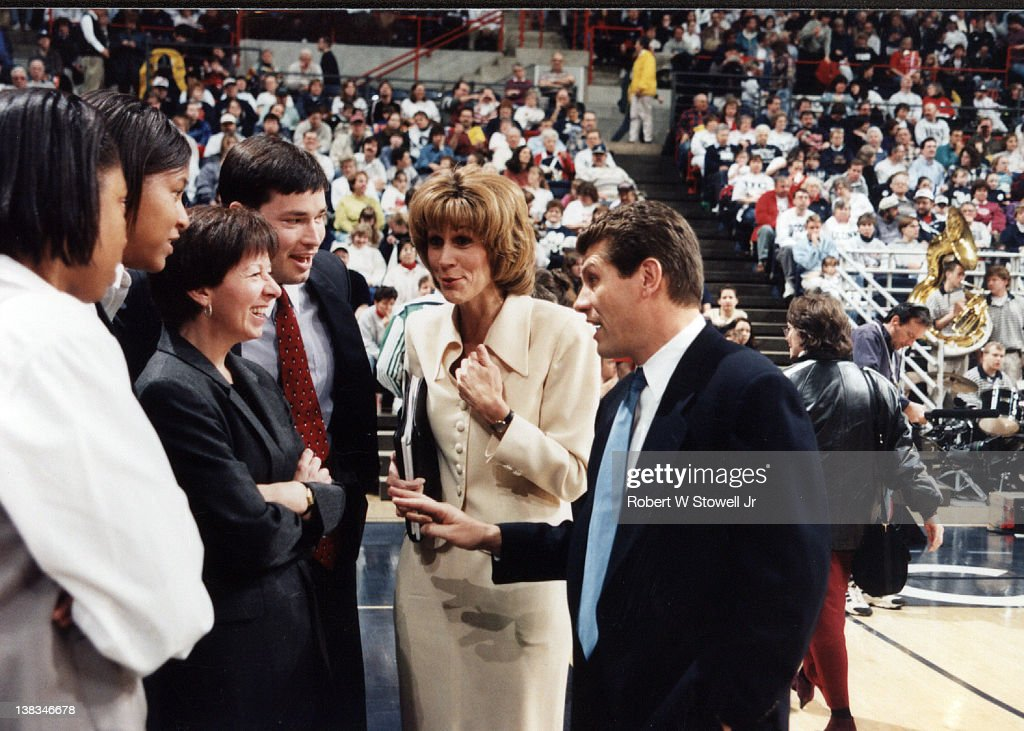 The University of Connecticut women's basketball coaches <a gi-track='captionPersonalityLinkClicked' href=/galleries/search?phrase=Geno+Auriemma&family=editorial&specificpeople=704607 ng-click='$event.stopPropagation()'>Geno Auriemma</a> (right) and Chris Dailey (in beige) talk with Notre Dame coach Muffet McGraw (with arms crossed) before a game, Storrs, Connecticut, 1995.