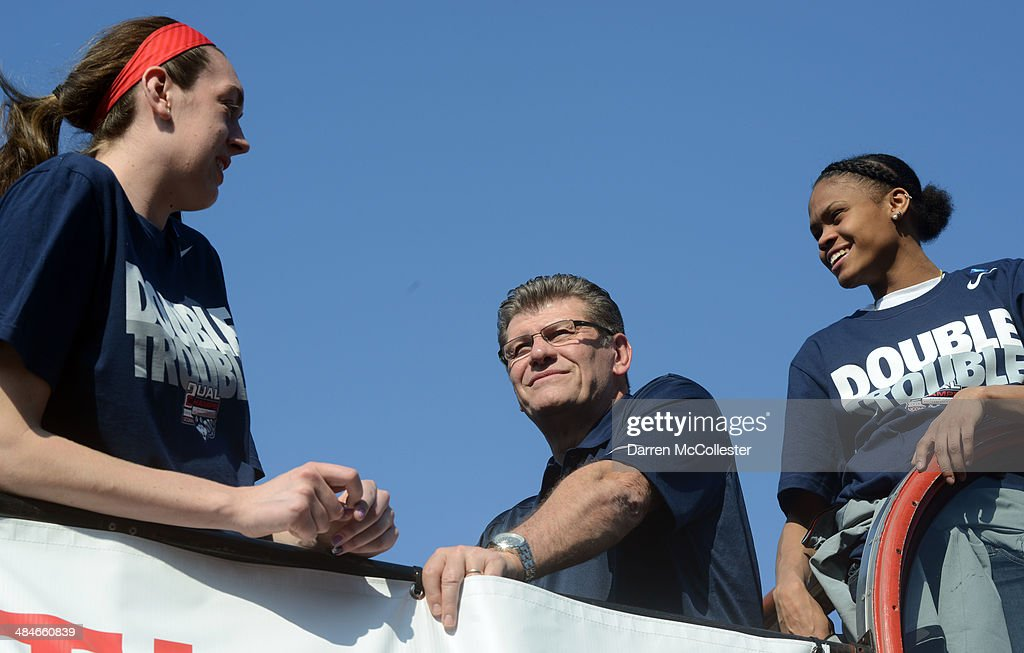 The University of Connecticut women's head coach Geno Auriemma and player Breanna Stewart (L) ride in an open bus during a victory parade April 13, 2014 in Hartford, Connecticut. This year was the second time both the men and women's Uconn Huskies basketball teams have won national championships in the same year.