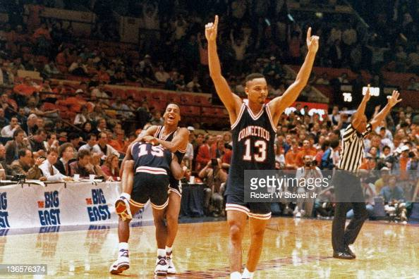The University of Connecticut's men's basketball team celebrates after winning the Big East basketball tournament New York 1990