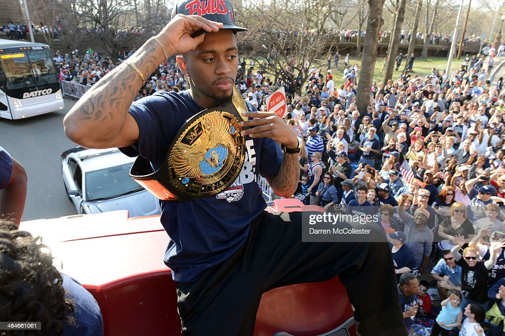 The University of Connecticut's Ryan Boatright rides in a victory parade to celebrate their national championship April 13, 2014 in Hartford, Connecticut. This year was the second time both the men's and women's Uconn basketball teams have won national championships in the same year.