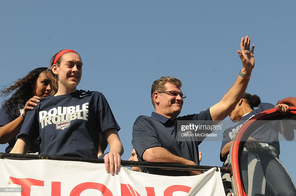 The University of Connecticut's women's head coach <a gi-track='captionPersonalityLinkClicked' href=/galleries/search?phrase=Geno+Auriemma&family=editorial&specificpeople=704607 ng-click='$event.stopPropagation()'>Geno Auriemma</a> and <a gi-track='captionPersonalityLinkClicked' href=/galleries/search?phrase=Breanna+Stewart&family=editorial&specificpeople=8564806 ng-click='$event.stopPropagation()'>Breanna Stewart</a> ride in a victory parade to celebrate their national championship April 13, 2014 in Hartford, Connecticut. This year was the second time both the men's and women's Uconn basketball teams have won national championships in the same year.