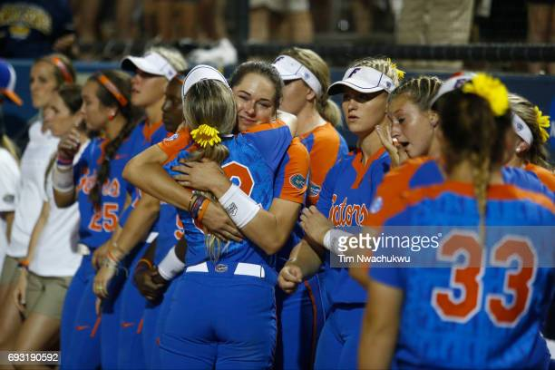 The University of Florida players cry after losing to the University of Oklahoma 54 in Game 2 of the Division I Women's Softball Championship held at...