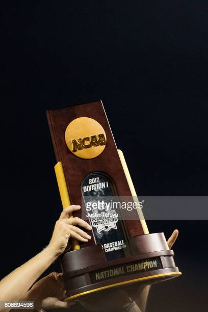 The University of Florida players hold up the trophy after game two of the Division I Men's Baseball Championship held at TD Ameritrade Park on June...
