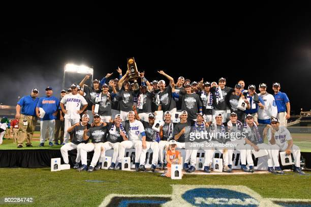The University of Florida team poses with the championship trophy after defeating Louisiana State University 61 during the Division I Men's Baseball...
