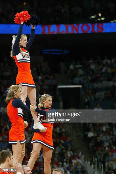 The University of Illinois Fighting Illini Cheerleaders perform during the second round game of the NCAA Division I Men's Basketball Tournament...