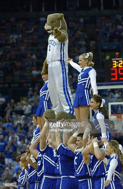 The University of Kentucky Wildcats cheerleaders form a pyramid during the SEC Men's Basketball Tournament at the Louisiana Superdome on March 14...