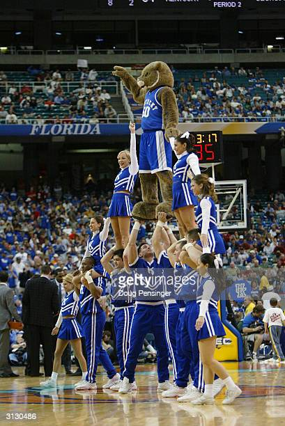 The University of Kentucky Wildcats mascot stands on top of a cheerleader pyramid during an intermission in the in the SEC Men's Basketball...