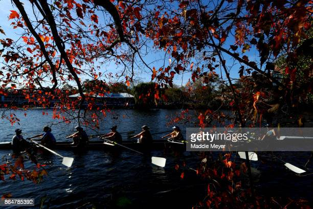 The University of Notre Dame Women's Alumni Eights team makes their way to the starting line during the Head of the Charles Regatta on October 21...