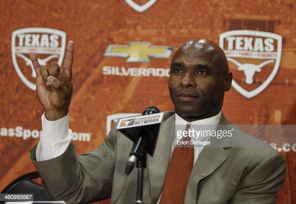 The University of Texas Longhorns new head football coach Charlie Strong from Louisville flashes the 'Hook 'Em Horns' sign after being introduced...