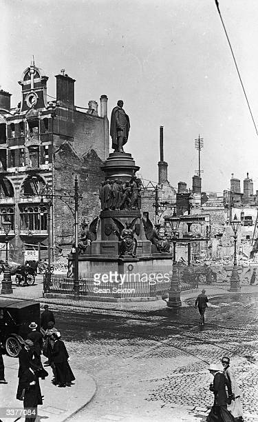 The unscathed O'Connell Monument amid the ruins of O'Connell Street Dublin after fighting during the Easter Rising