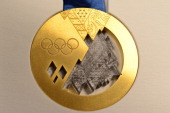 The unveiled Sochi 2014 Olympic Gold Medal is displayed during an IOC executive board meeting at the SportAccord International Convention in St...